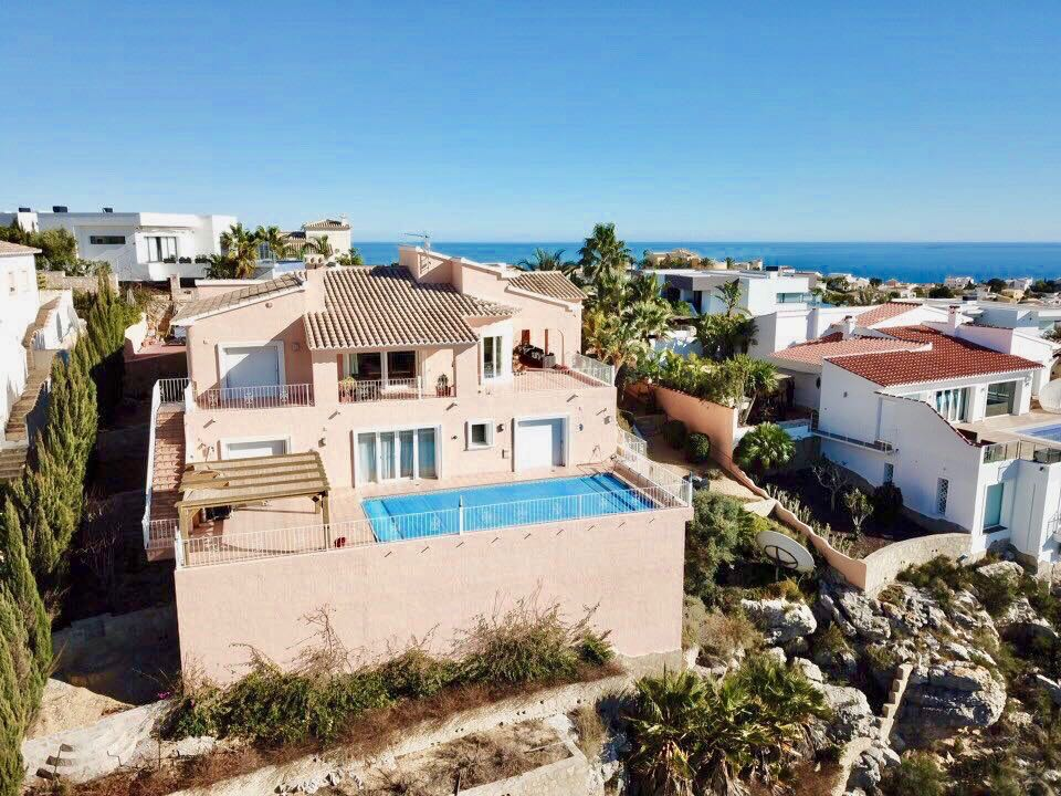 This spacious villa with stunning views to Calpe and Benidorm is set in professionally landscaped , Spain